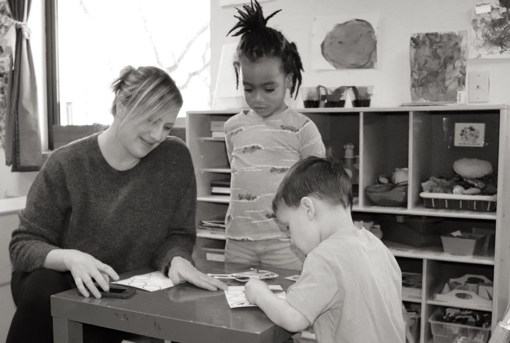 Woman with two children from Ladybug Early Learning
